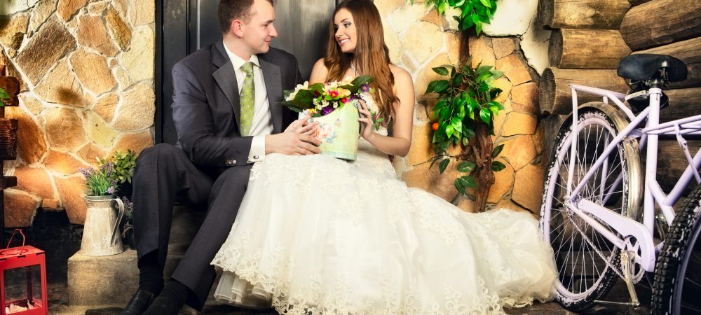 charming bride and groom on porch of house